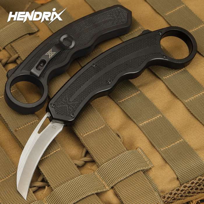 The awesome Karambit OTF Knife from Hendrix Gear is one part karambit and one part double-action OTF