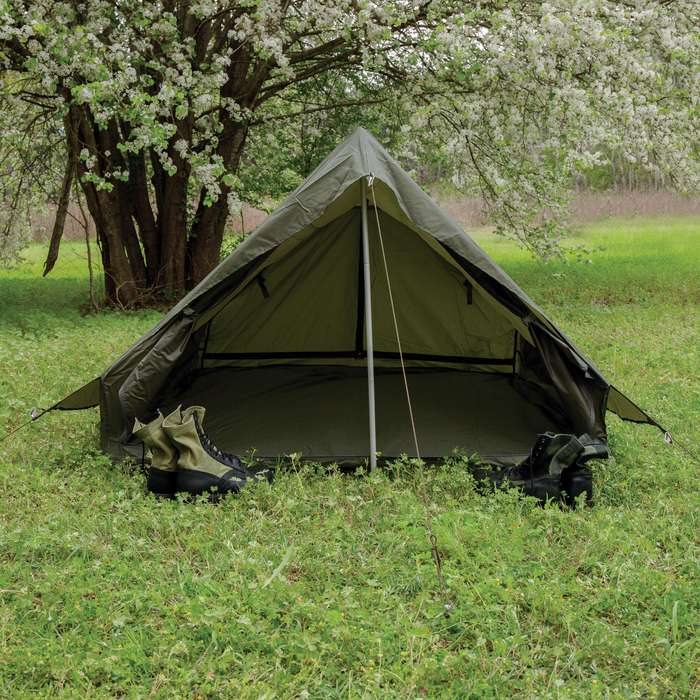 The like new tent is made of water-resistant, olive drab nylon material with sturdy, metal zipper closure front and back openings
