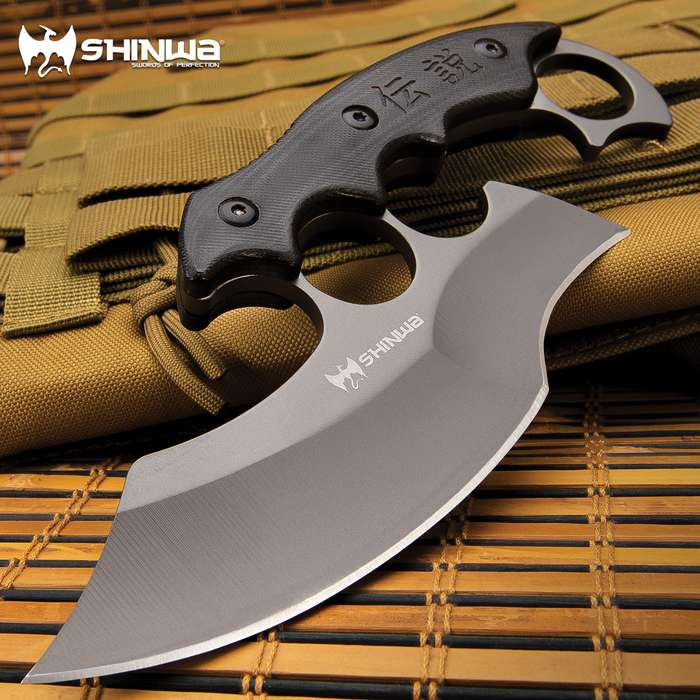 A uniquely designed fixed blade, which combines elements from the traditional karambit and ulu knife, along with a modified knuckle guard
