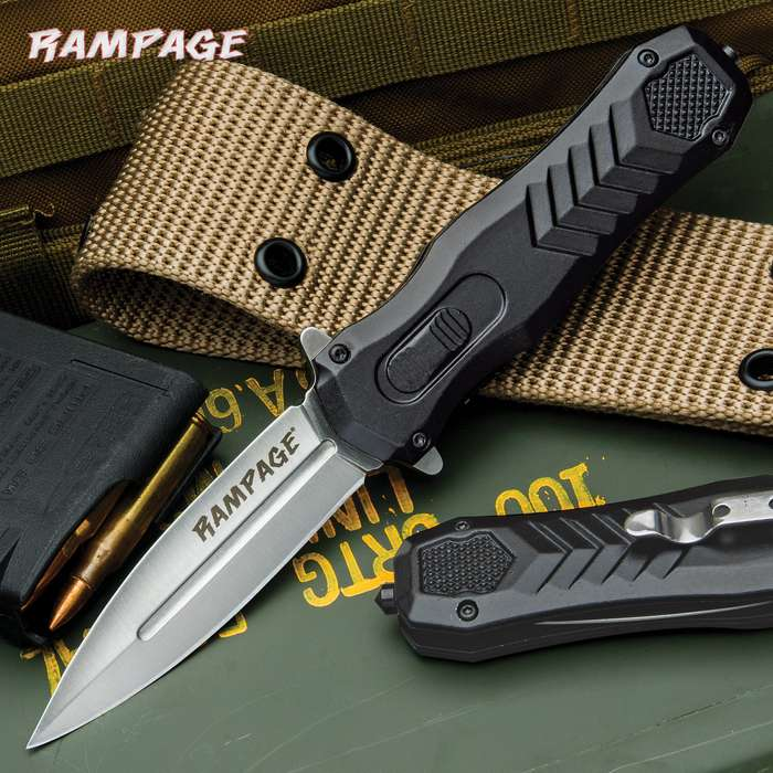 The Rampage Faux OTF Knife, when closed, gives the illusion of an OTF, complete with a molded faux trigger switch