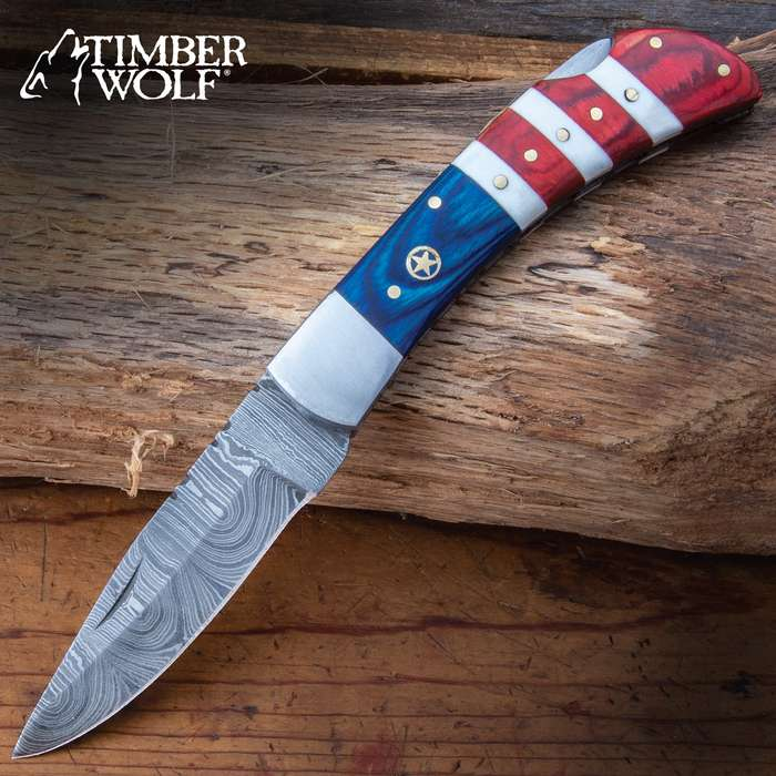 An All-American classic design makes the Timber Wolf USA Tribute Pocket Knife a must-have addition for your collection