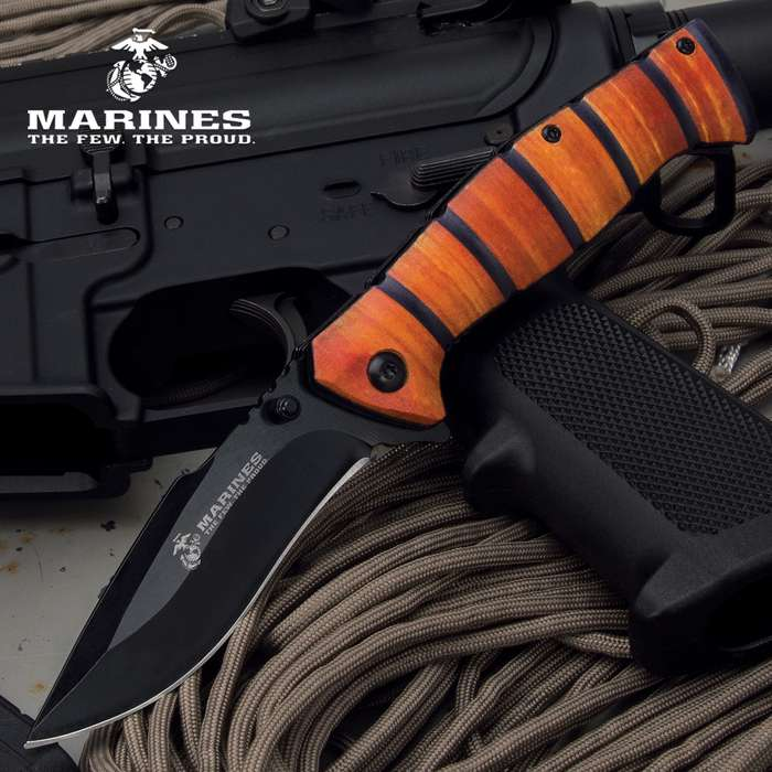 An homage to the iconic fixed blade knife carried by Marines for decades, it has the familiar stacked leather handle look