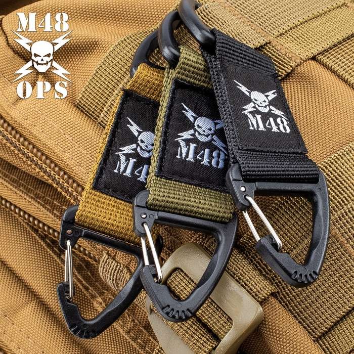 "Three-Pack Tactical Webbing Clips - Nylon Webbing And ABS Construction - Dimensions 4""x1"""