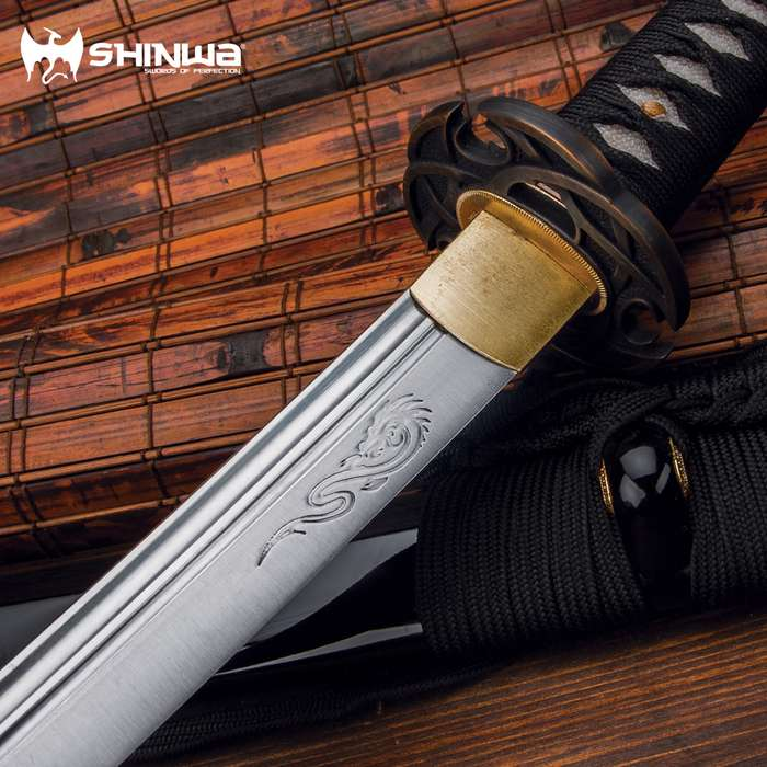 """It has a hand-forged, 28 3/4"""" carbon steel blade"""