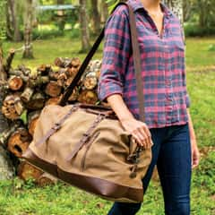 Outback Traveler Duffel Bag - Canvas Construction, Soft Lining, Spacious Interior, Leather Accents, Multiple Pockets, Metal Hardware