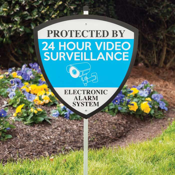 This sign doesn't mince words, warning any would-be home invader that they're being watched