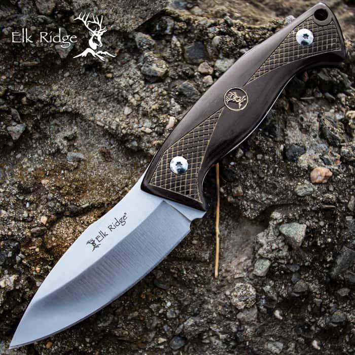 elk ridge black pakkawood handle hunting knife on a rock