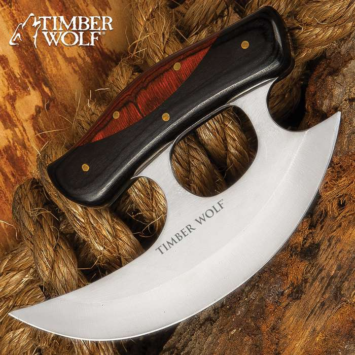 "The Slicer Ulu Knife from Timber Wolf has a razor-sharp, curved 7"" stainless steel reaper-style blade perfect for slicing and chopping tasks in the kitchen or at the camp"