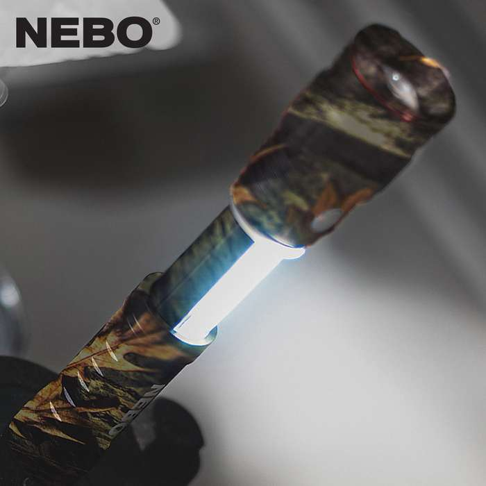 The work light is concealed inside the Nebo Slyde King Flashlight body and it automatically turns on when opened and off when closed