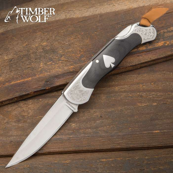 The Timber Wolf Gambler Lockback Pocket Knife has an Old West gambler feel with its wood and polished steel construction, accented by an ace medallion