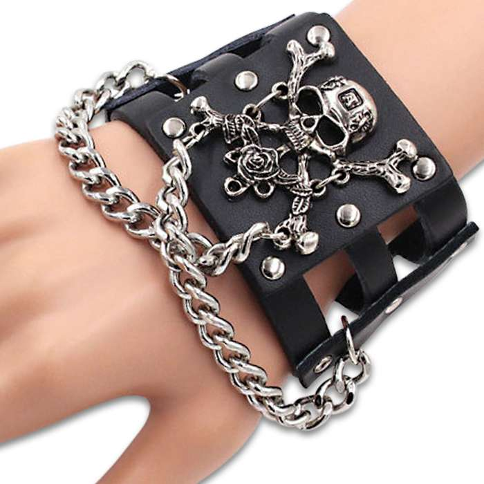 "Hardcore Skull And Crossbones Cuff Bracelet - Made Of Leather, Stainless Steel Accents, Snap Closure - Length 9""x 1 1/2"""