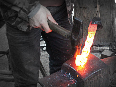 Forged layers of steel being hammered