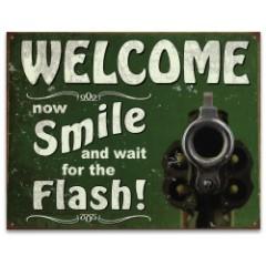 "Vintage Style Tin Sign - Welcome Smile for Flash - Gun Pistol Revolver Handgun Bullet; Antiqued Weathered Patina; Green - Reloading Room, Garage, Man Cave, Bar, Cabin, Home Decor - 12 1/2"" x 16"""